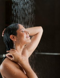 Young woman taking a shower